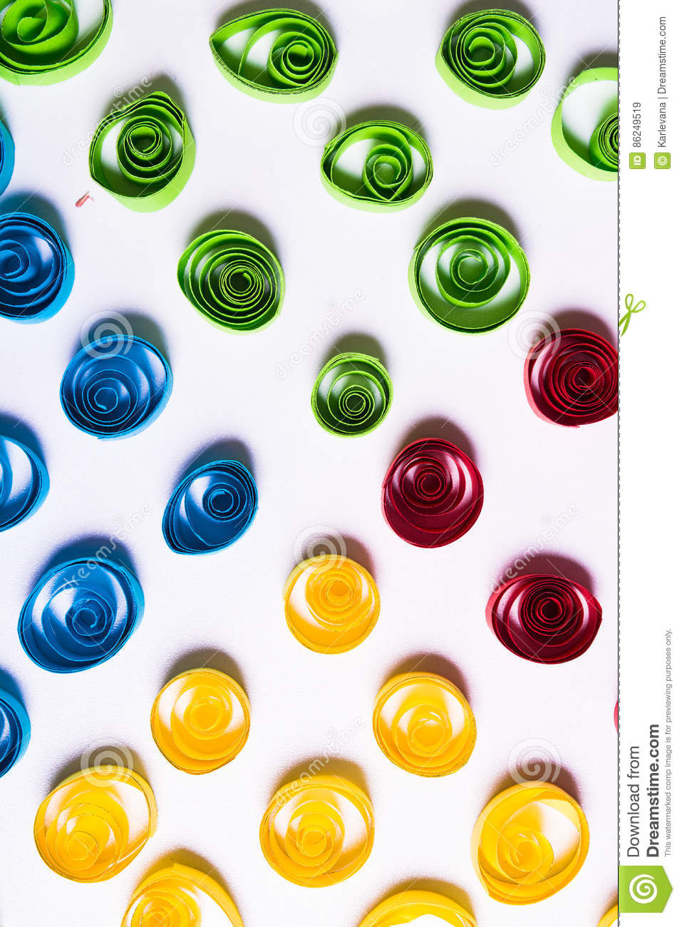 Quilling art. Color paper curls on the white background