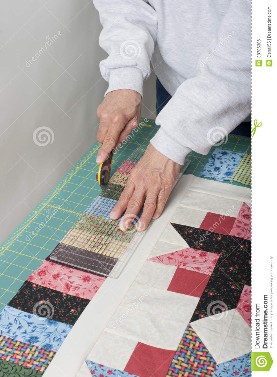 Quilter Trimming Piano Keys Of Quilt Top Fabric. Stock Photo ... : piano key quilt border - Adamdwight.com