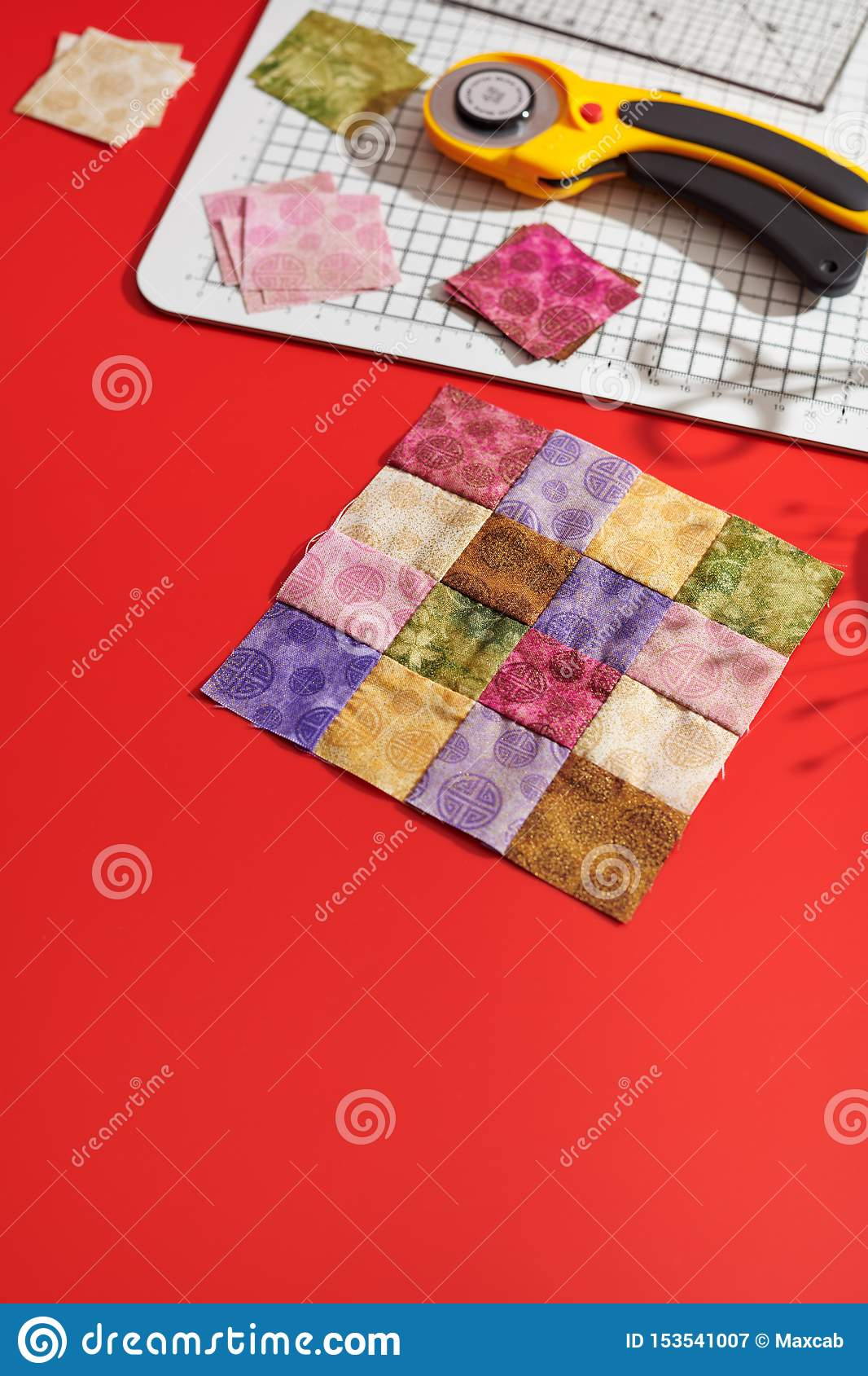 Quilting Block From Bright Square Pieces Of Fabrics Rotary