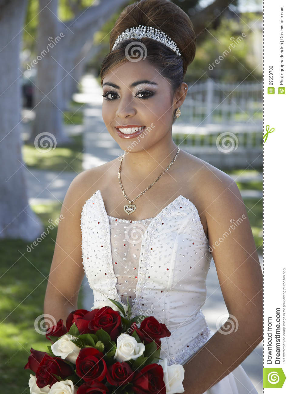 Quinceanera With Flower Bouquet In Lawn Stock Photo Image Of Latin