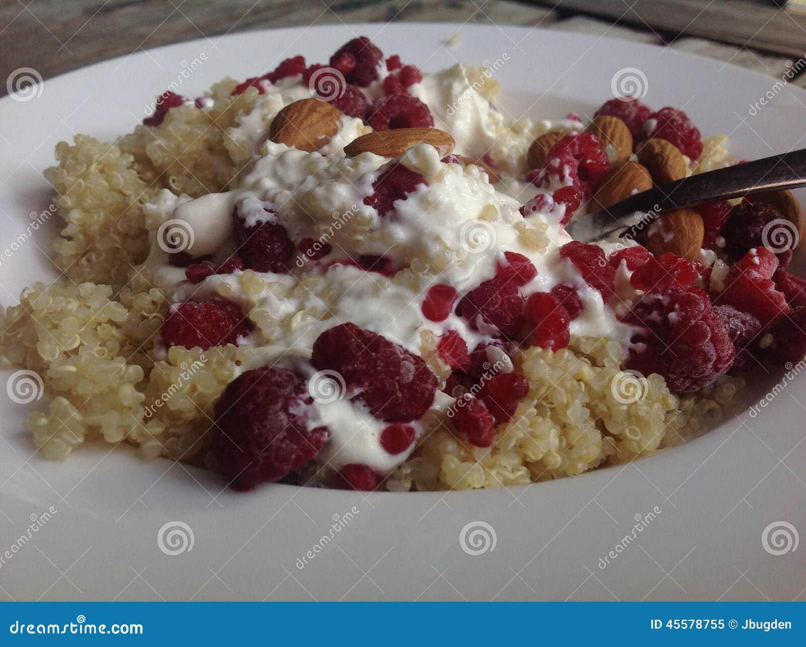 Quinoa Porridge With Raspberries, Almonds And Yoghurt Stock Photo ...