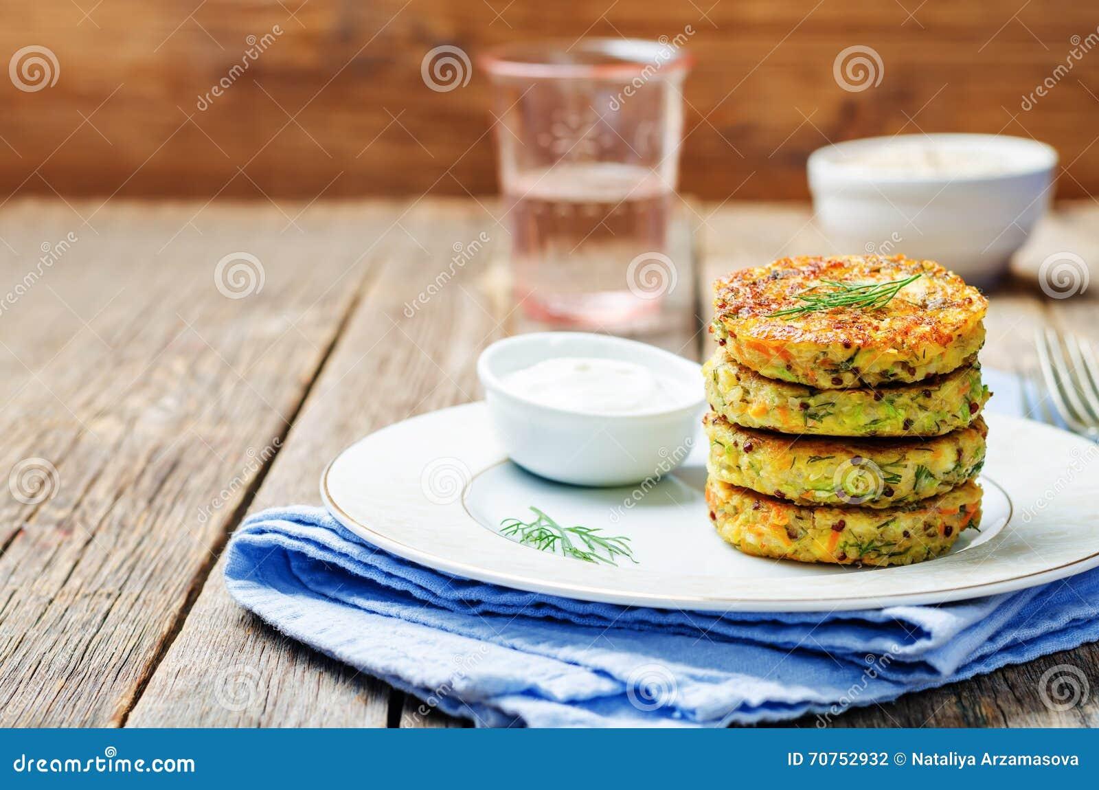 Quinoa Zucchini feta dill fritters on dark wooden background. toning ...