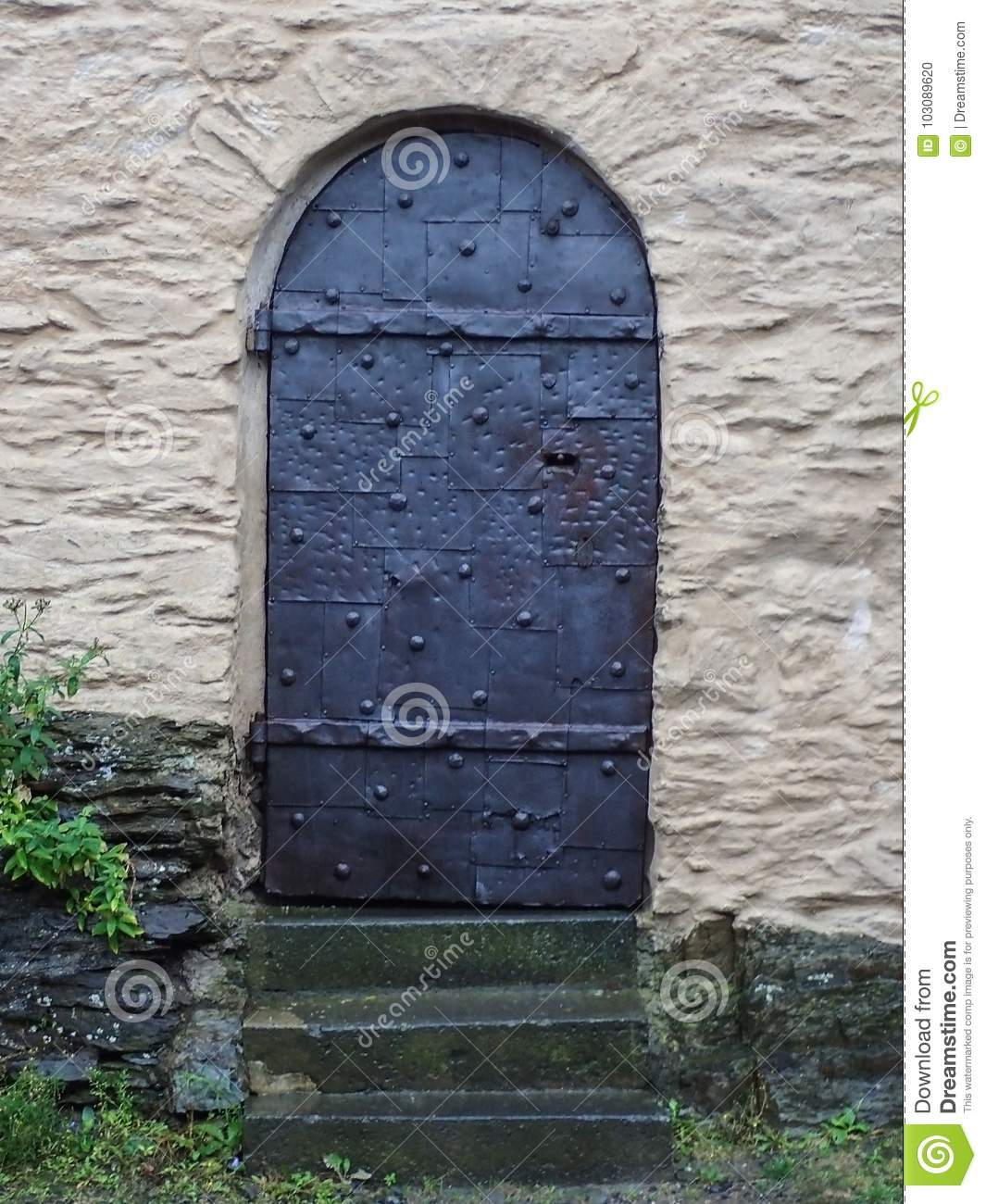 Quirky Castle Door Made of Iron Sheets and Bolts