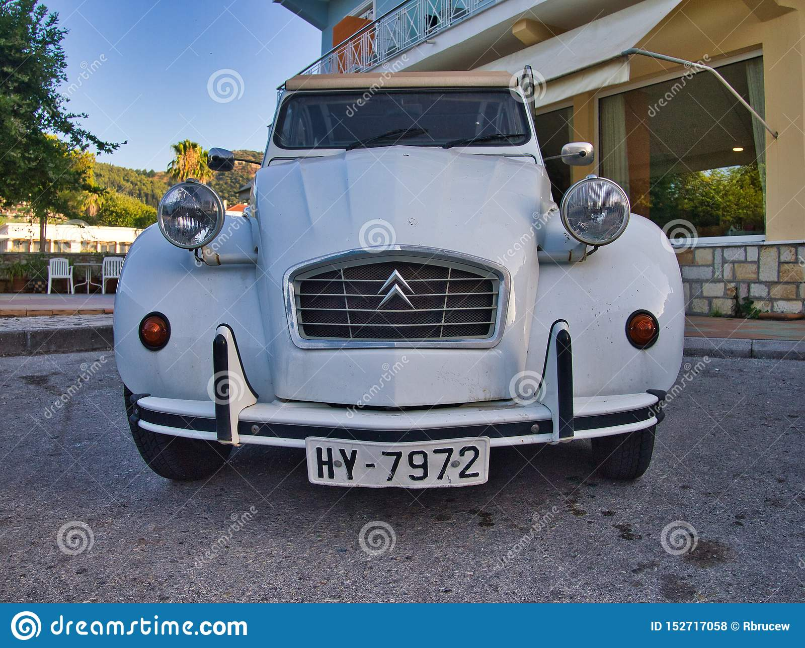 Vintage Citroen 2CV Car Parked on Side of Road