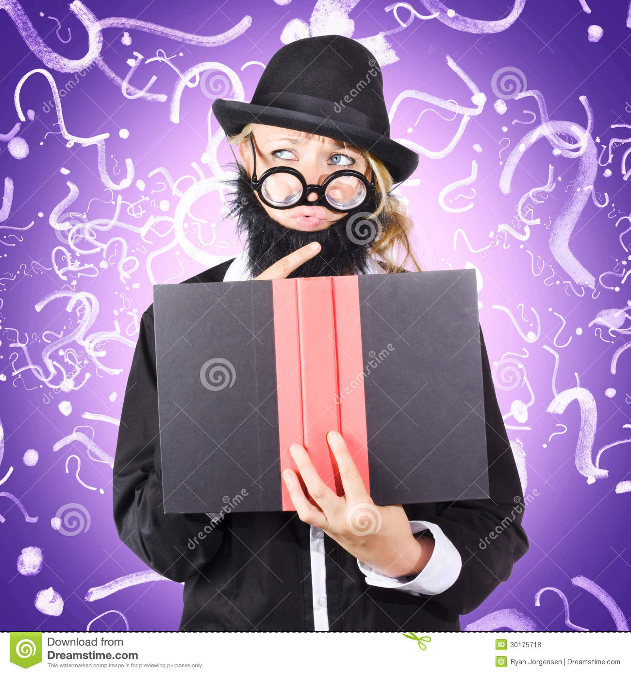 question man reading puzzle solving book stock photo