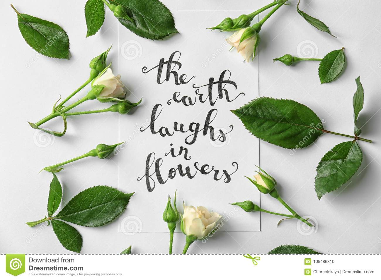 Quote The Earth Laugh In Flowers Written On Paper With Roses And