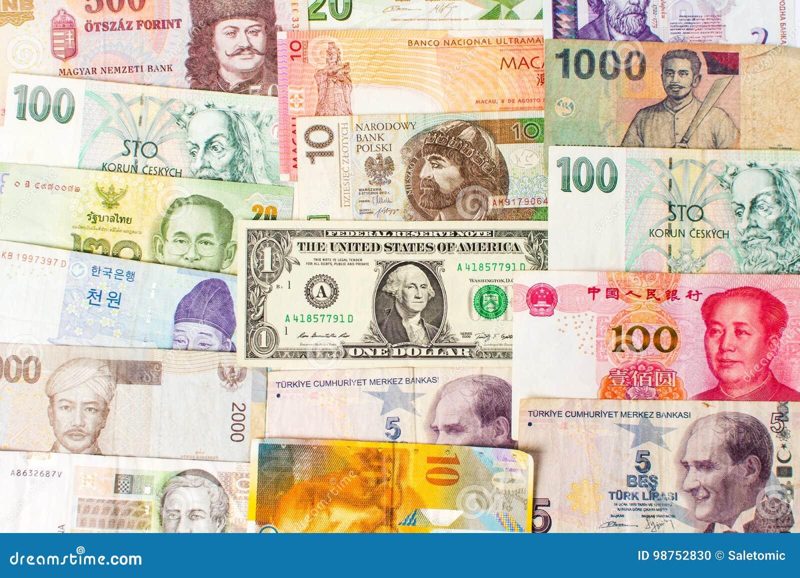 Różnorodni waluta banknoty tworzy tło