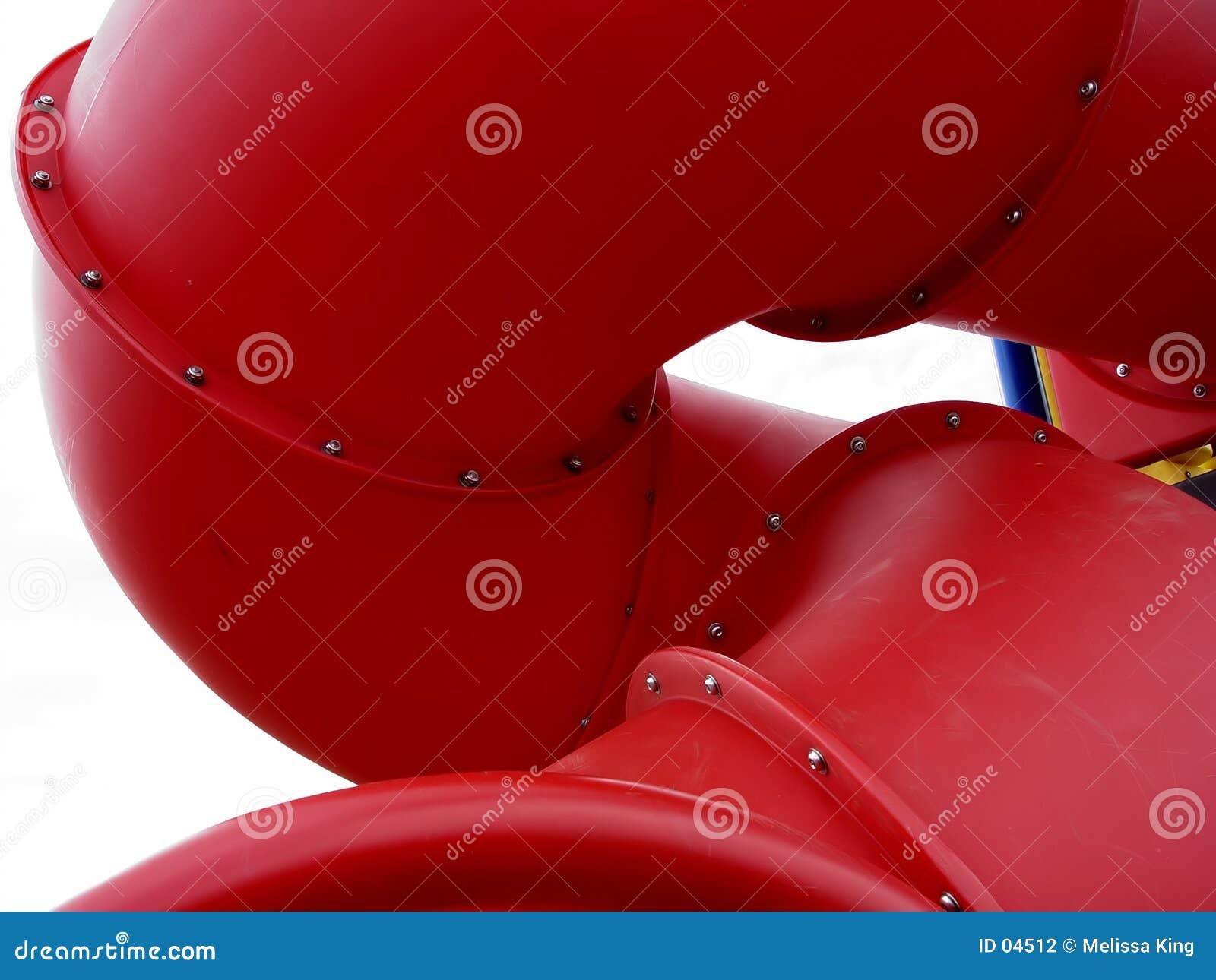 Röd glidbana för lekplats