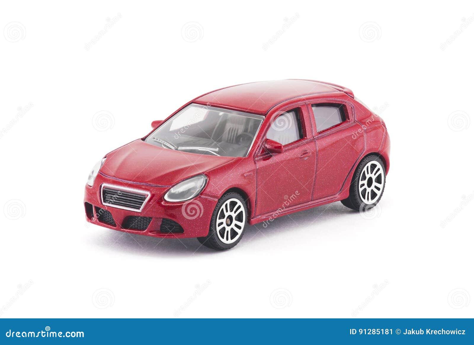 Röd leksakbil på vit bakgrund