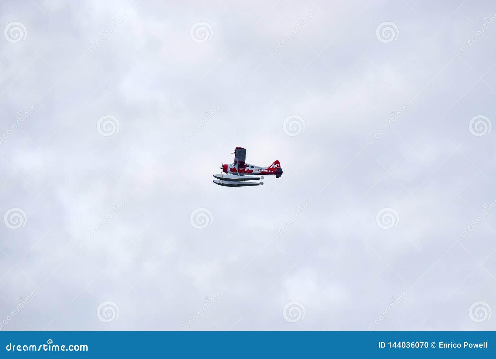 Röd och vit enkel sjöflygplan för utterhamnluft