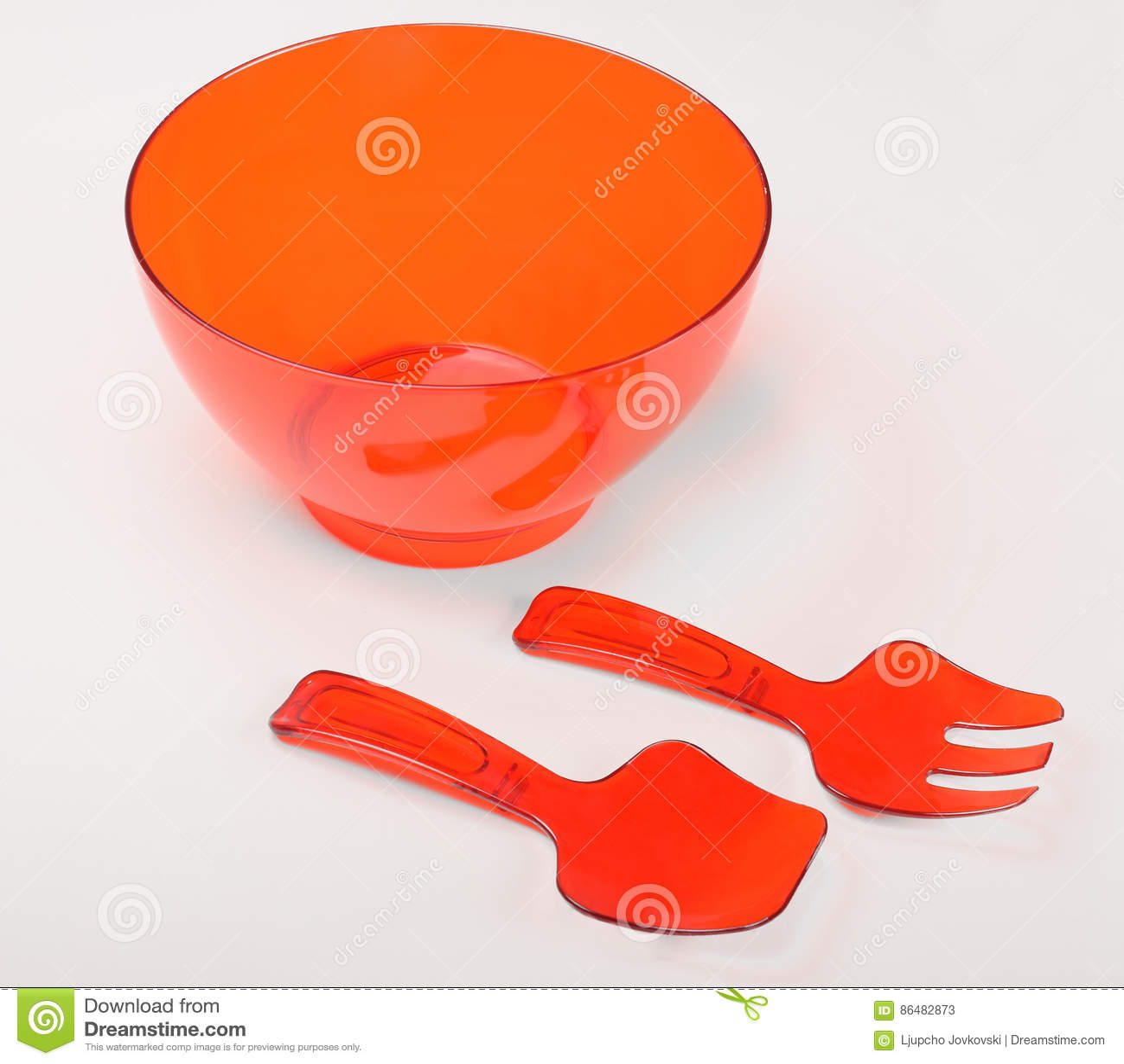 Röd plast- behållare för omrörning av kakan