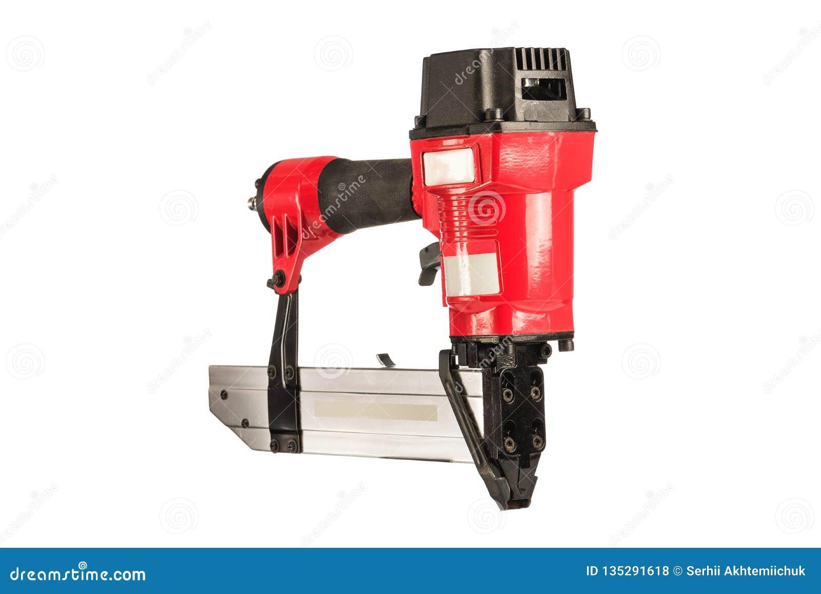 Röd pneumatisk häftapparat på en vit bakgrund isolerat