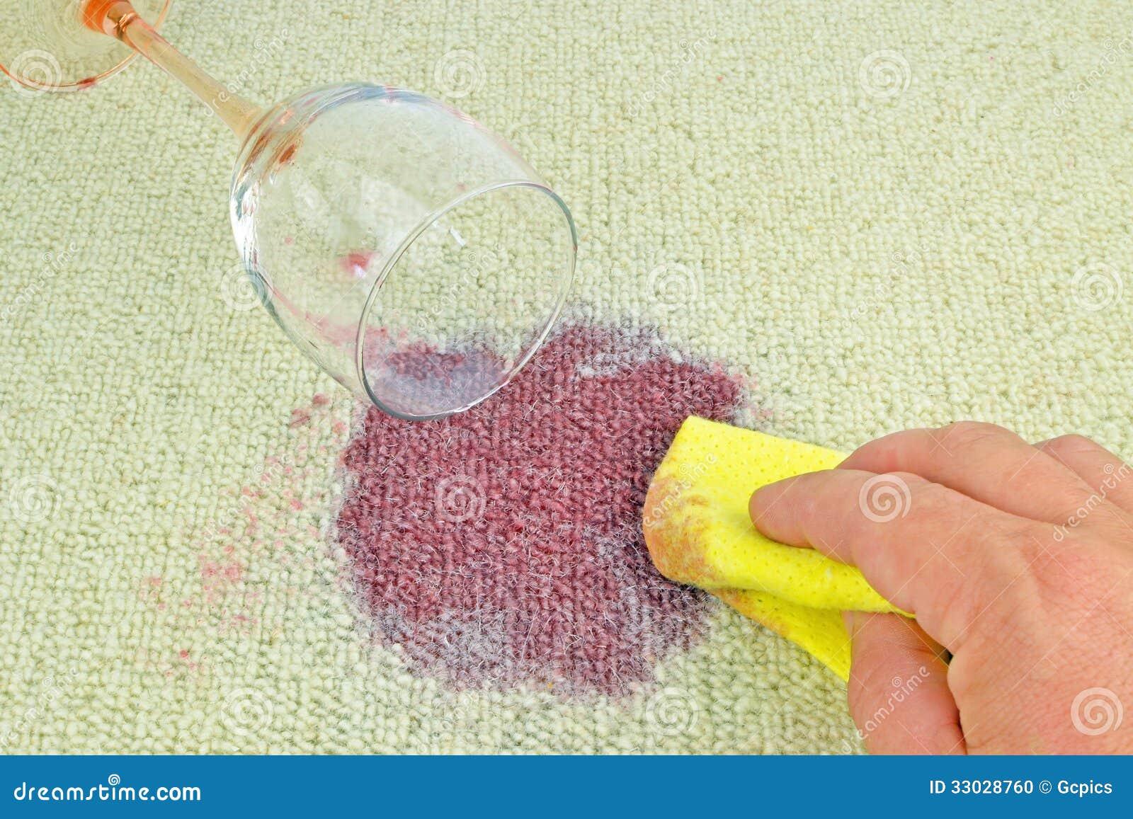 Rött vin på en matta