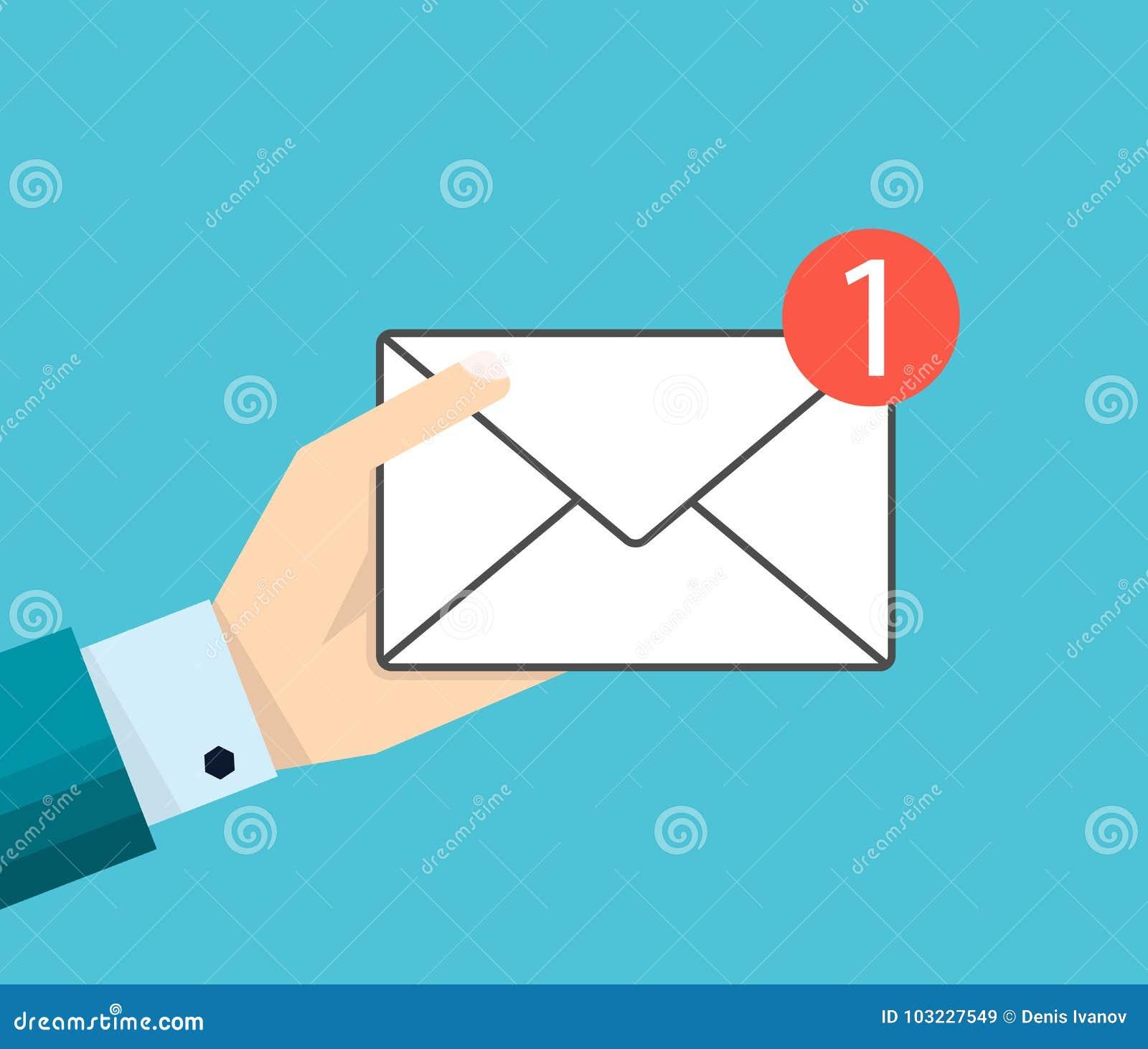Ręka biznesmen trzyma email wiadomość lub ikonę