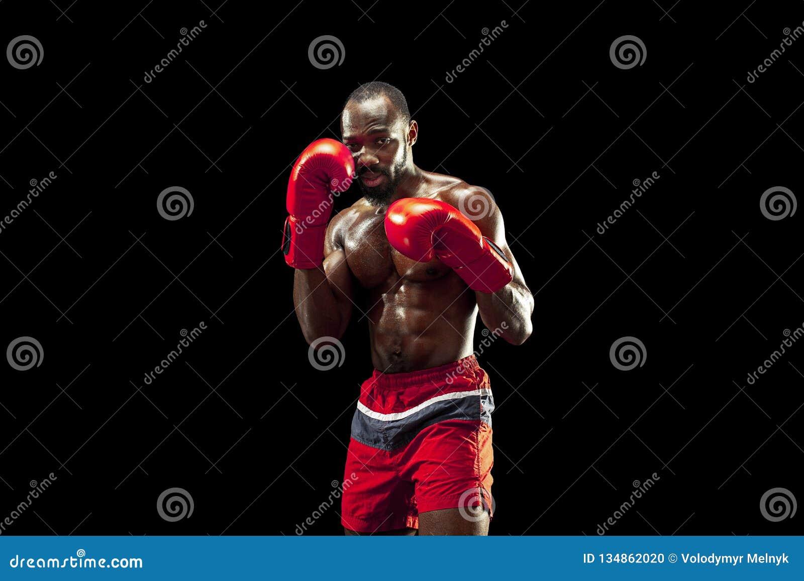 Ręka bokser nad czarnym tłem Siły, ataka i ruchu pojęcie,