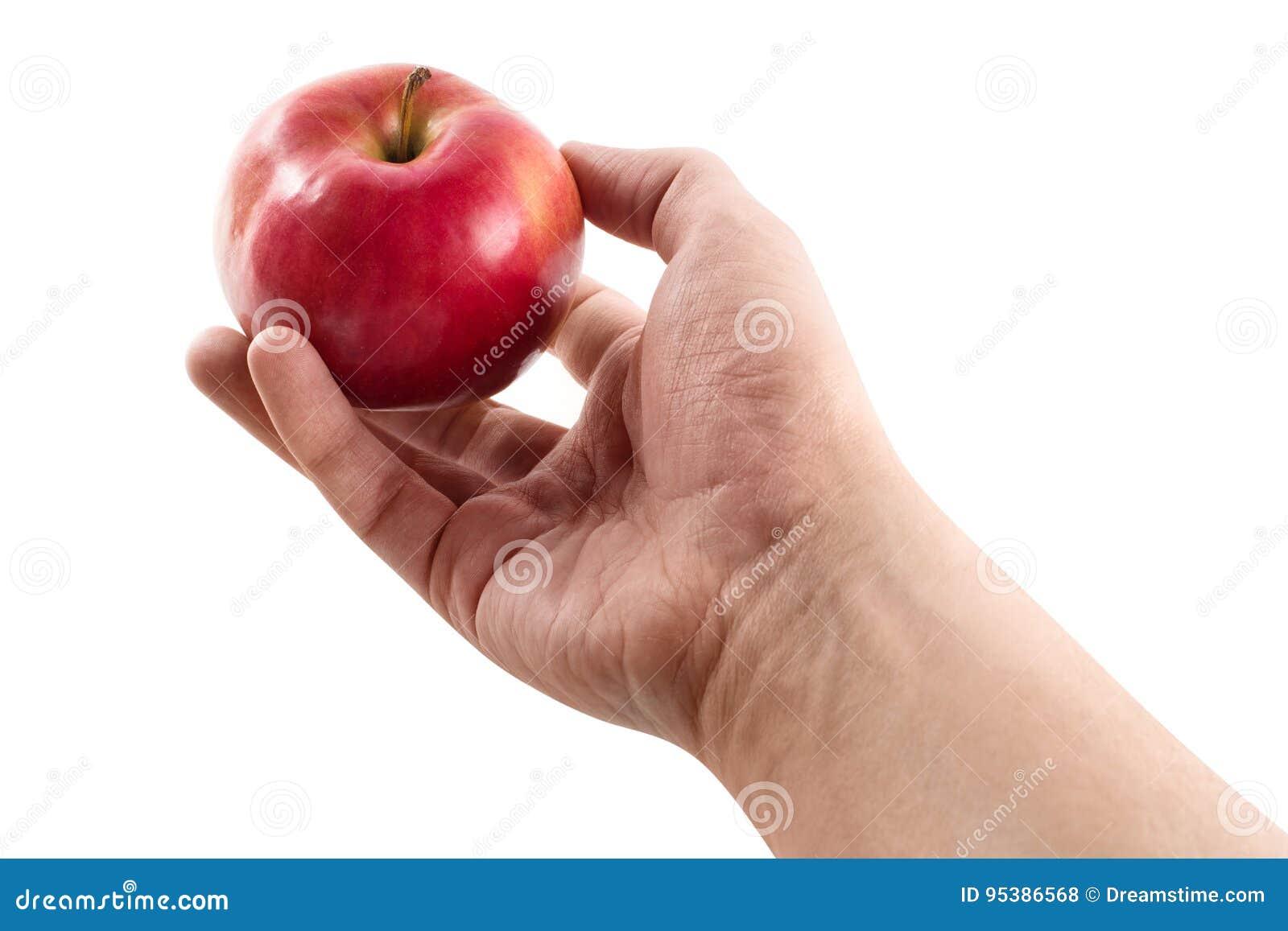 Ręka i jabłko odizolowywający na białym tle,