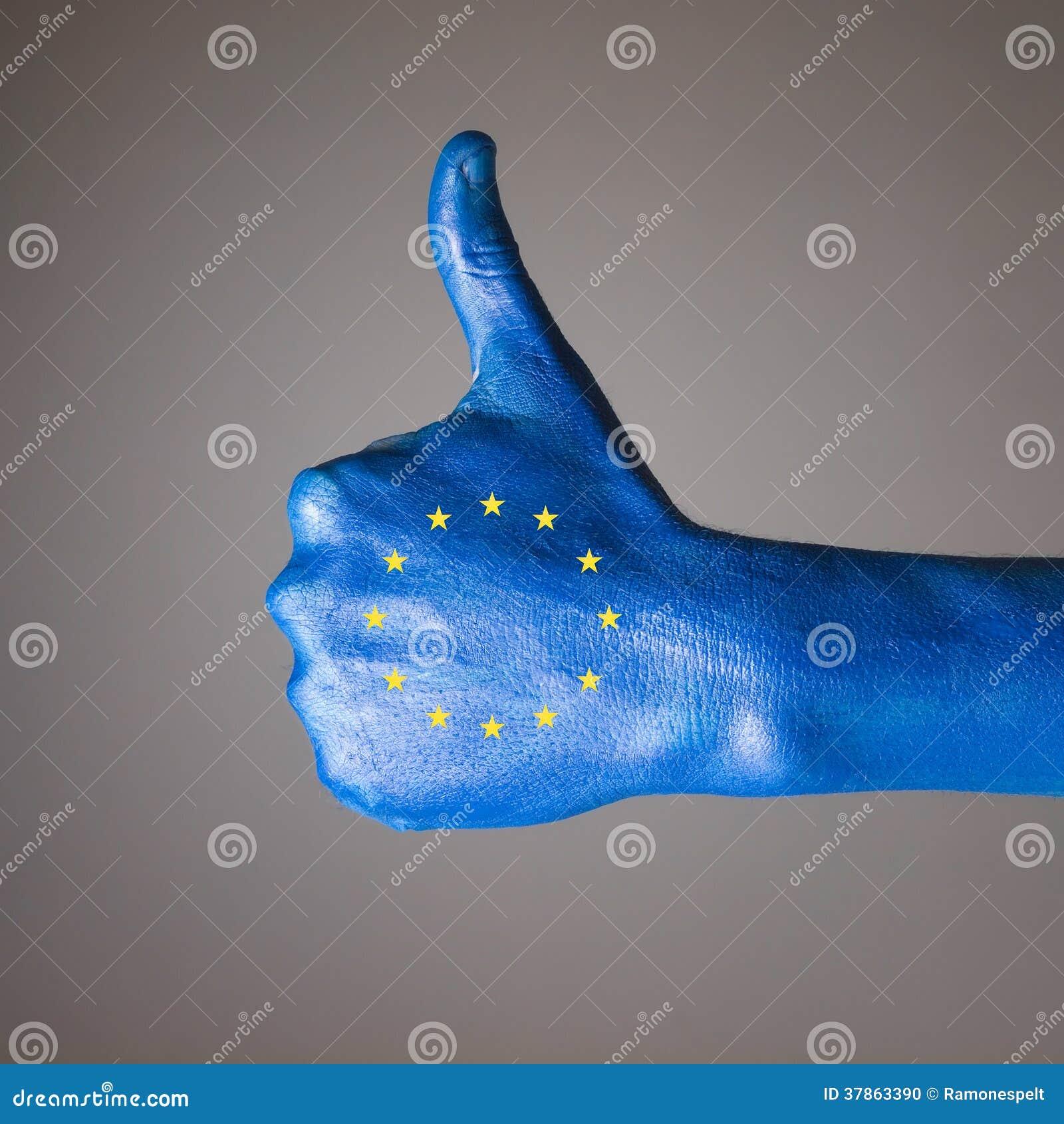 Ręka malująca z flaga wspólnota europejska