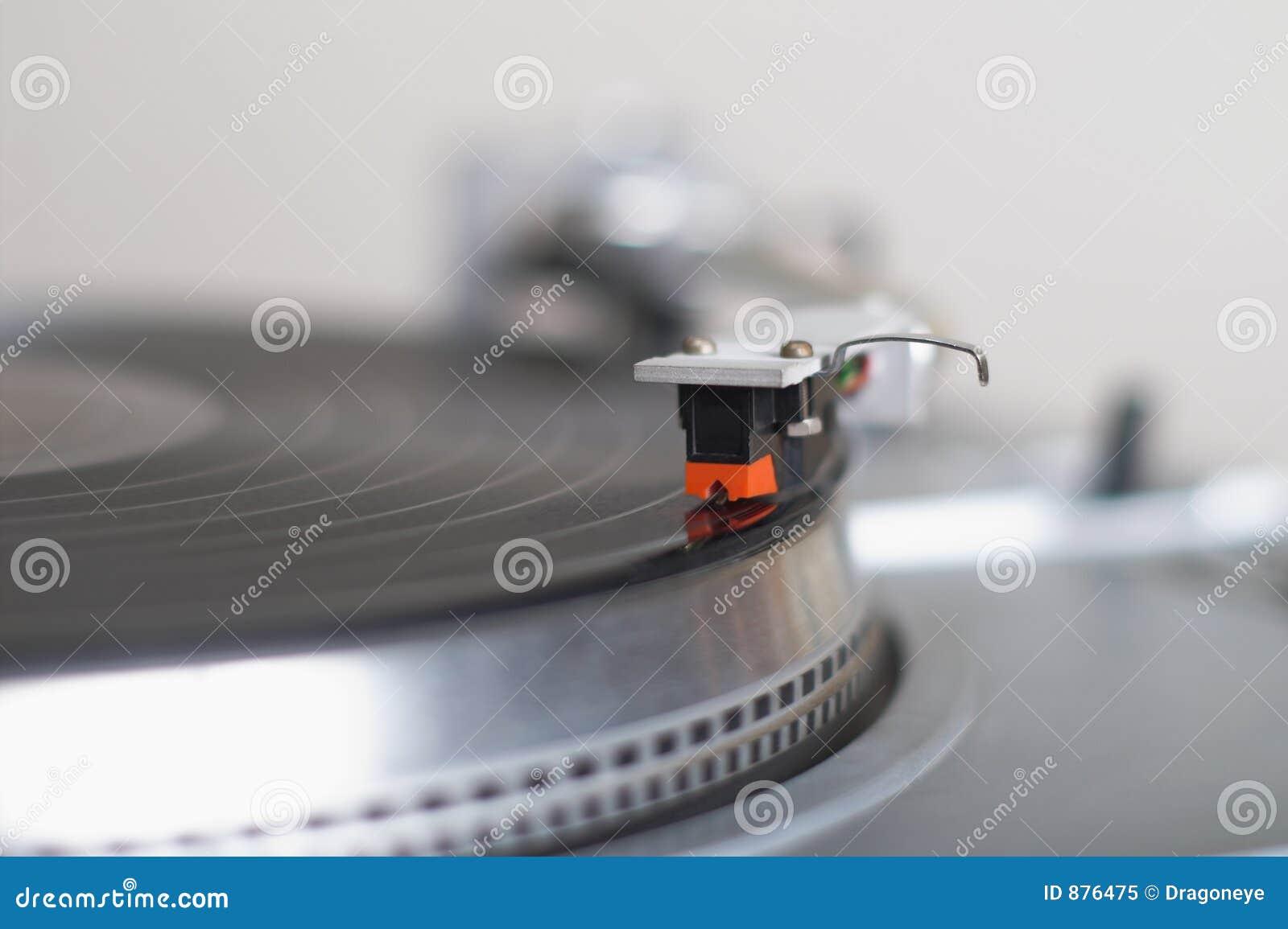 Ręka nabojowy dysk się gramofon ton