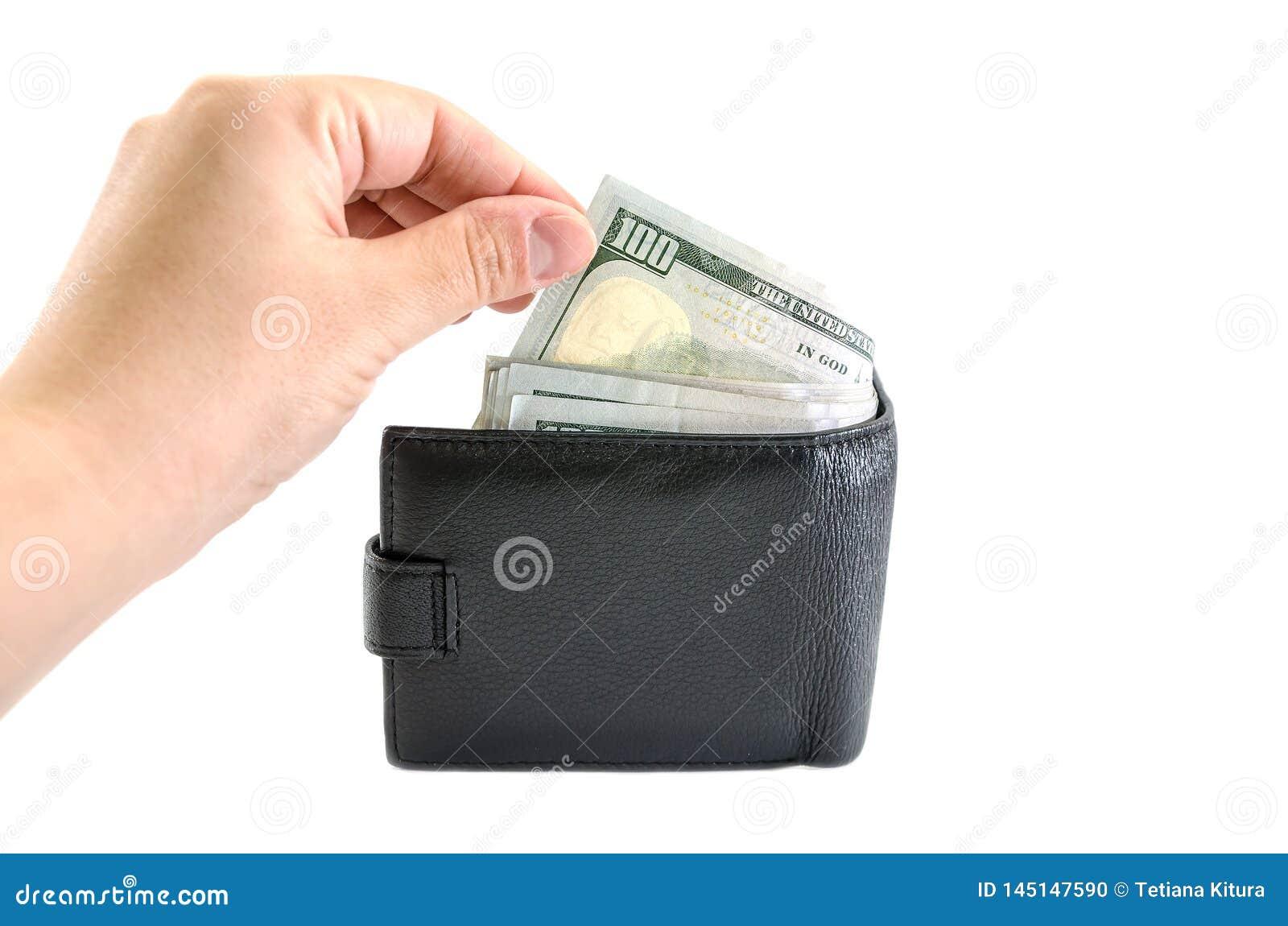 Ręka wyciąga dolary od kiesy na białym tle