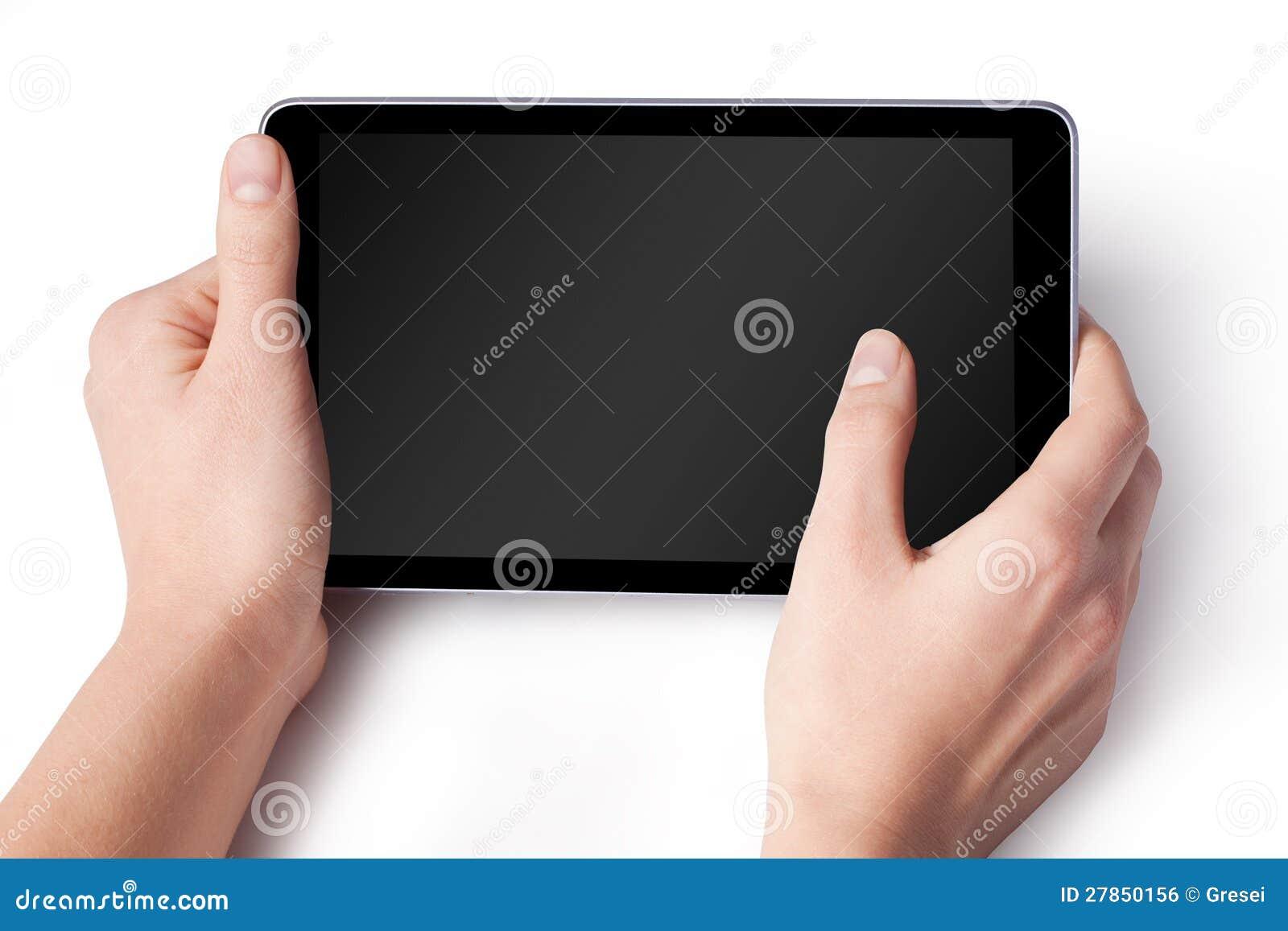 Ręki z pastylka komputerem