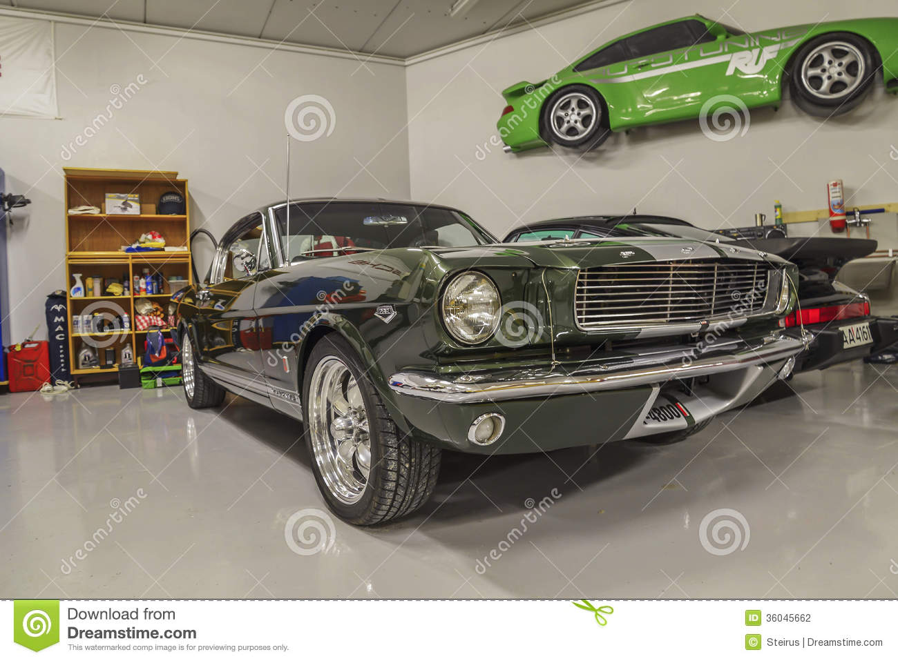 Race cars in a garage editorial photography. Image of auto - 36045662