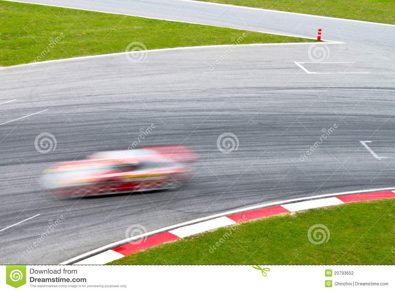 Race track with a blurred sport car