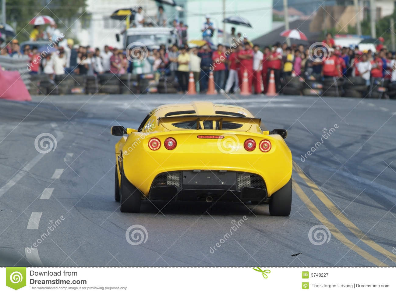 Racing car and spectators