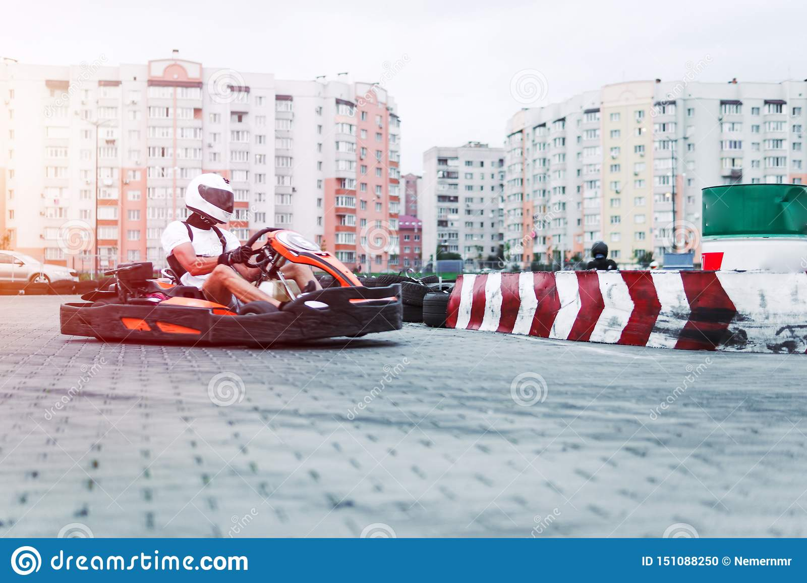 Racing car on the track in action, championship, active sports, extreme fun, the driver keeps his hands on the wheel. protective