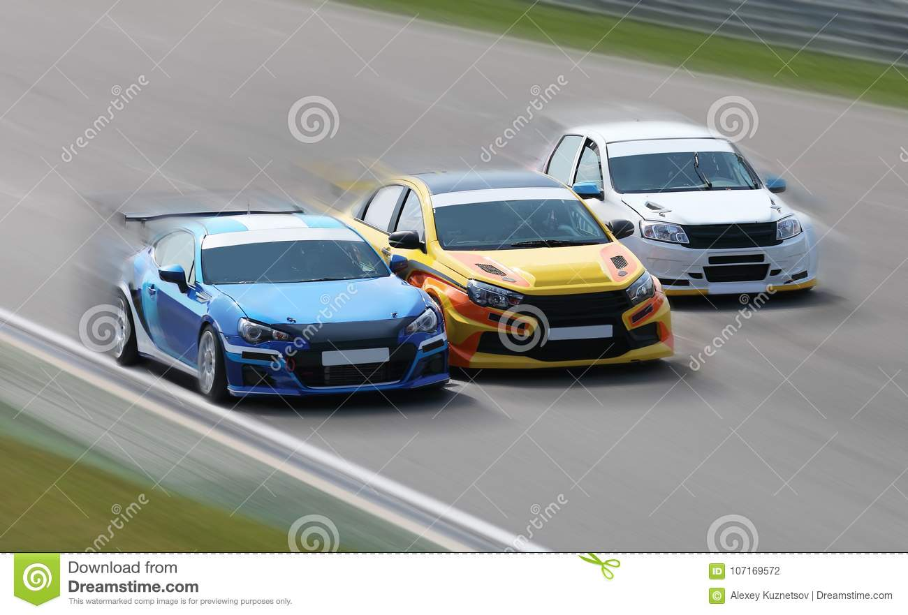 Download Racing Cars On A Track Stock Photo