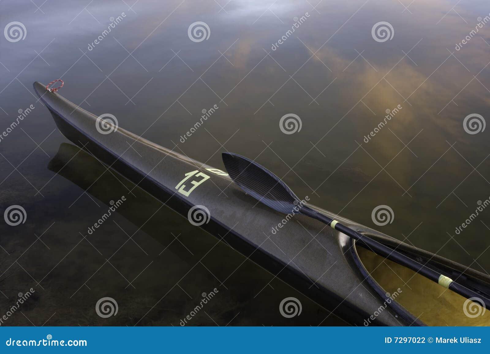 Download Racing Kayak, Wing Paddle, Calm Lake Stock Photo - Image of racing, boat: 7297022