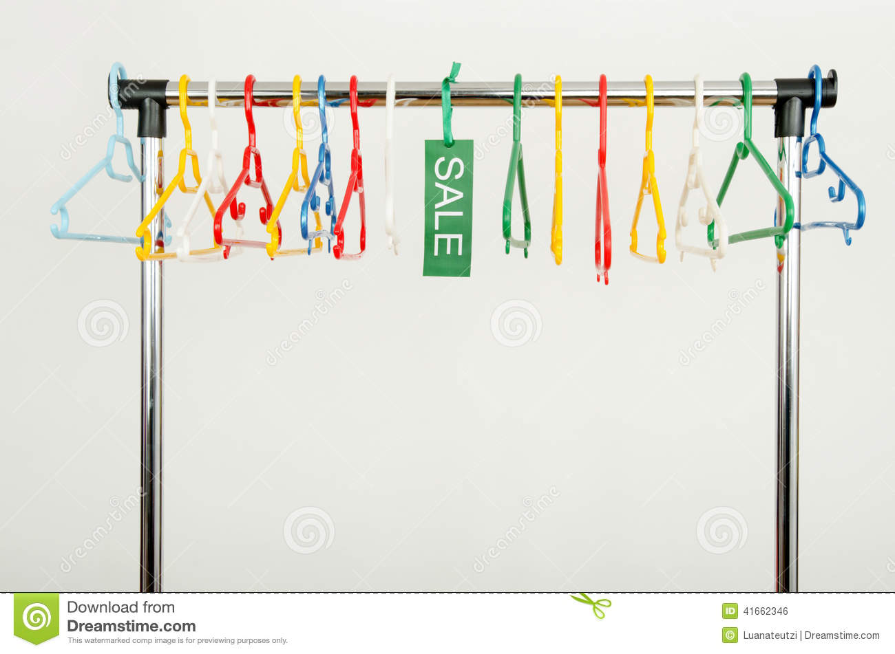 Rack Of Clothes With Empty Hangers And A Sale Sign. Stock Photo
