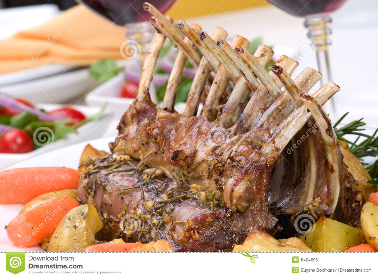 Rack of Lamb (ribs) with Rosemary garlic dressing, garnished with baby ...