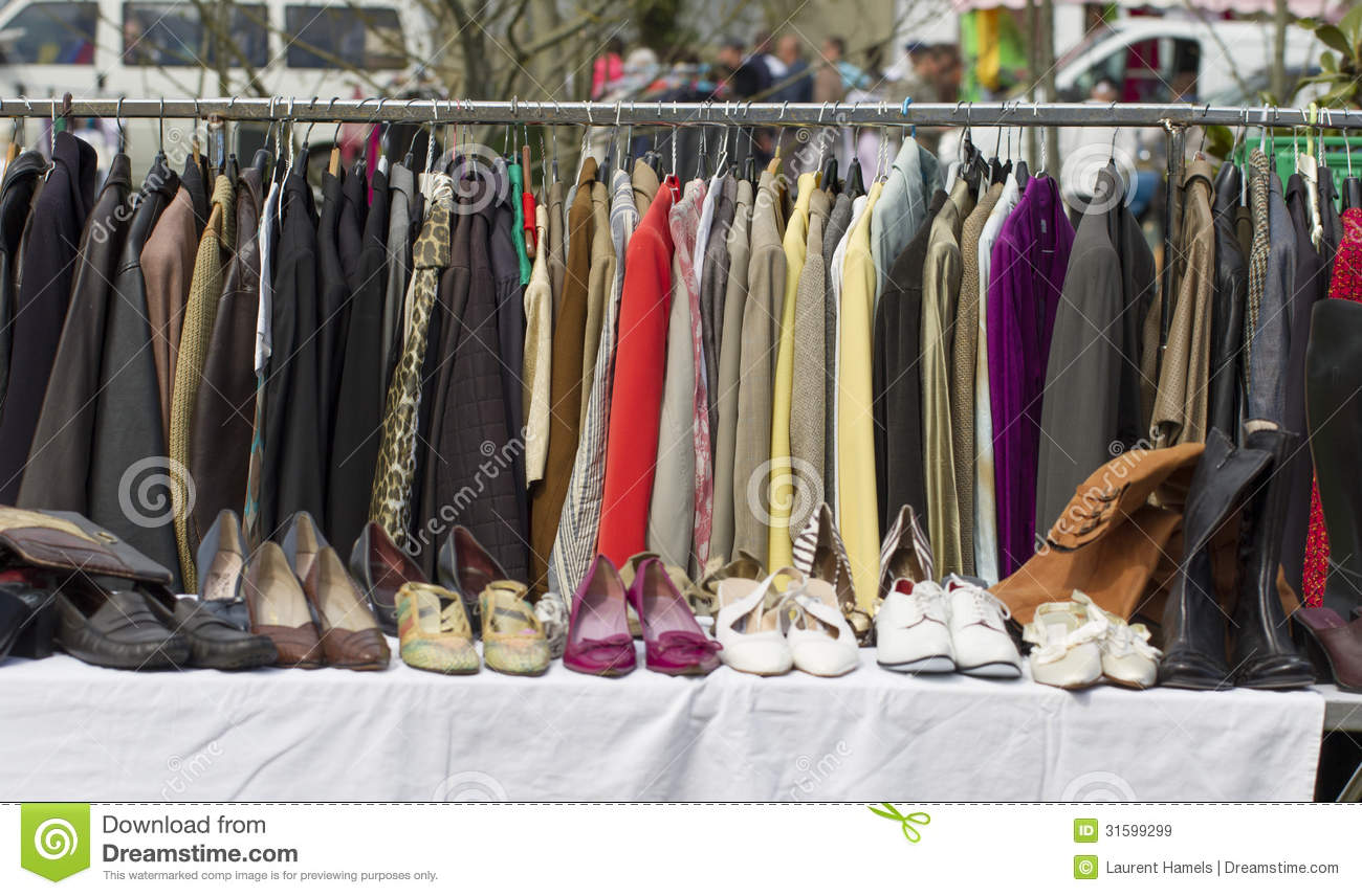 Rack Of Out Of Season Jackets And Shoes Outdoors Stock