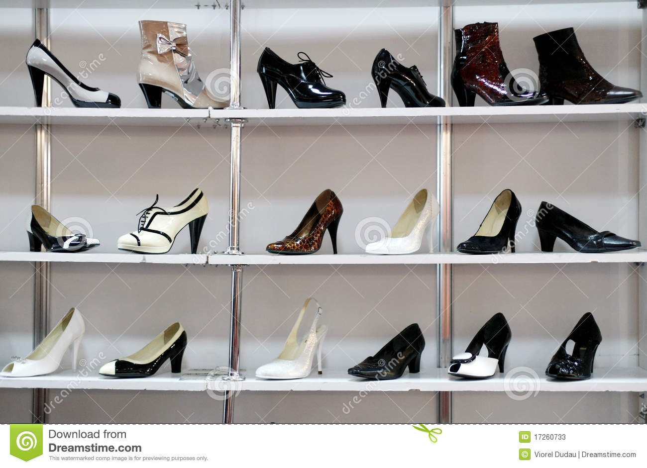 Women Trying Shoes On Smiling In Shoe Shop Stock Photo, Picture