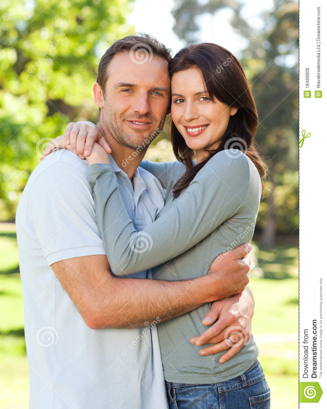 Radiant Couple Hugging In The Park Stock Photo