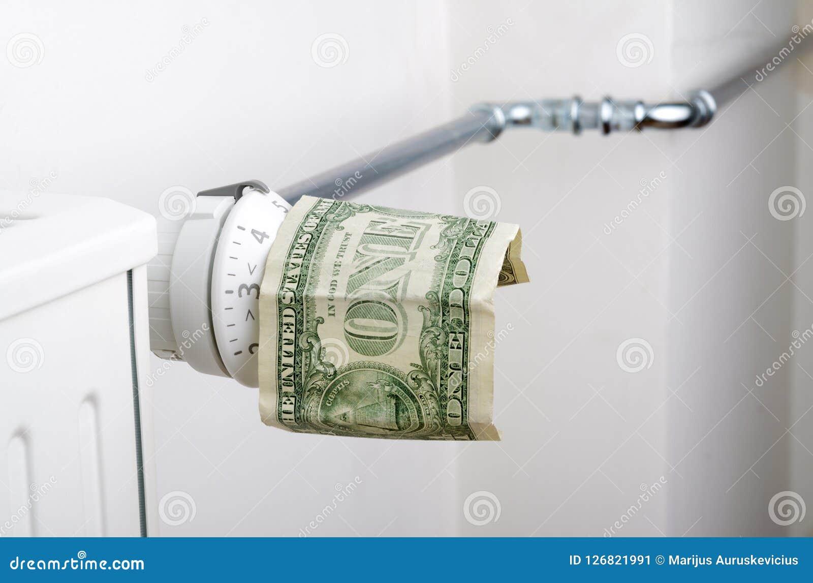 Radiator and one dollar. Money on heating battery. Heating season concept Stock Image