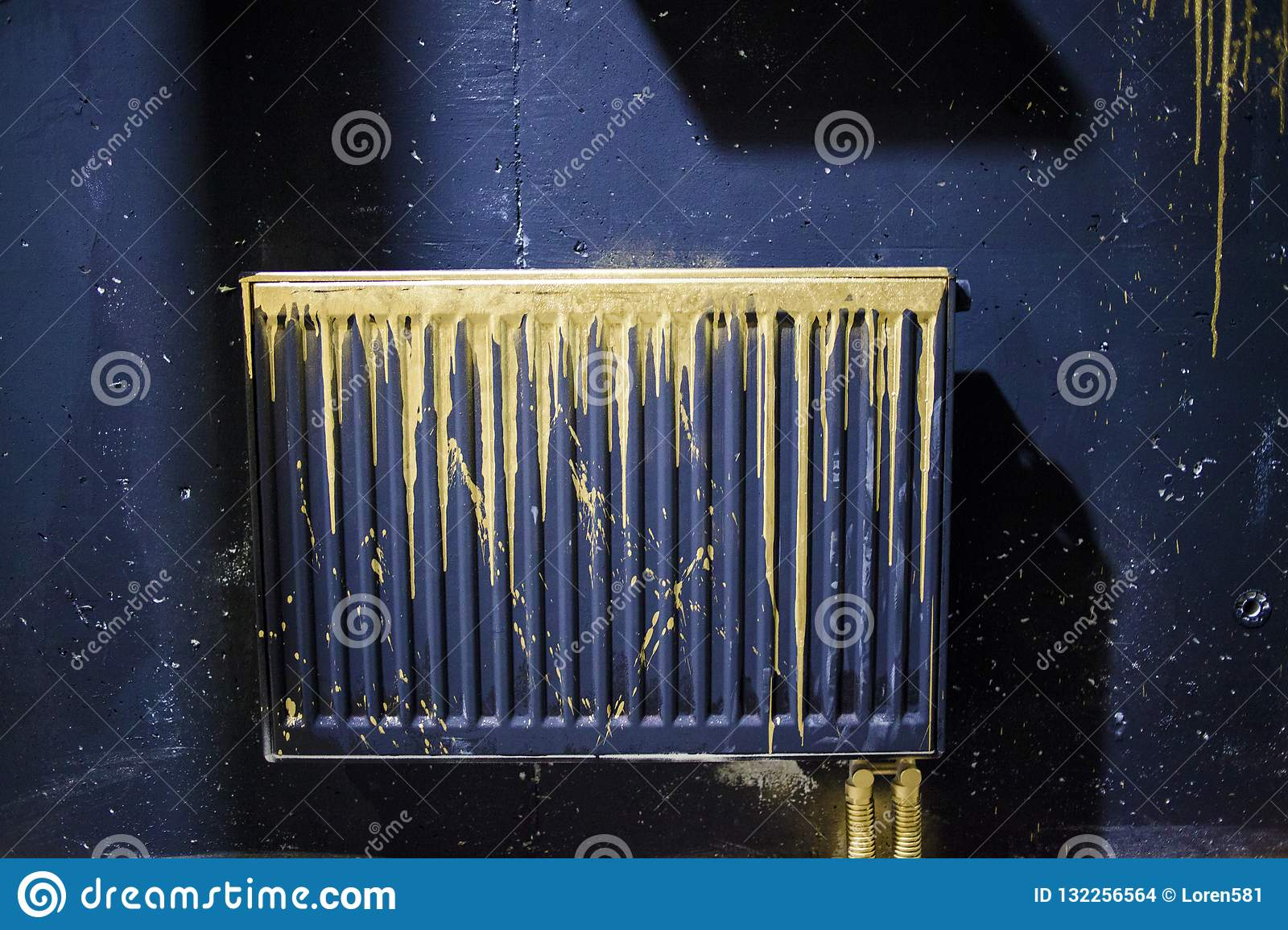 A Radiator Painted Black With Gold Streaks Of Paint Stock Photo Image Of Closeup Surface 132256564