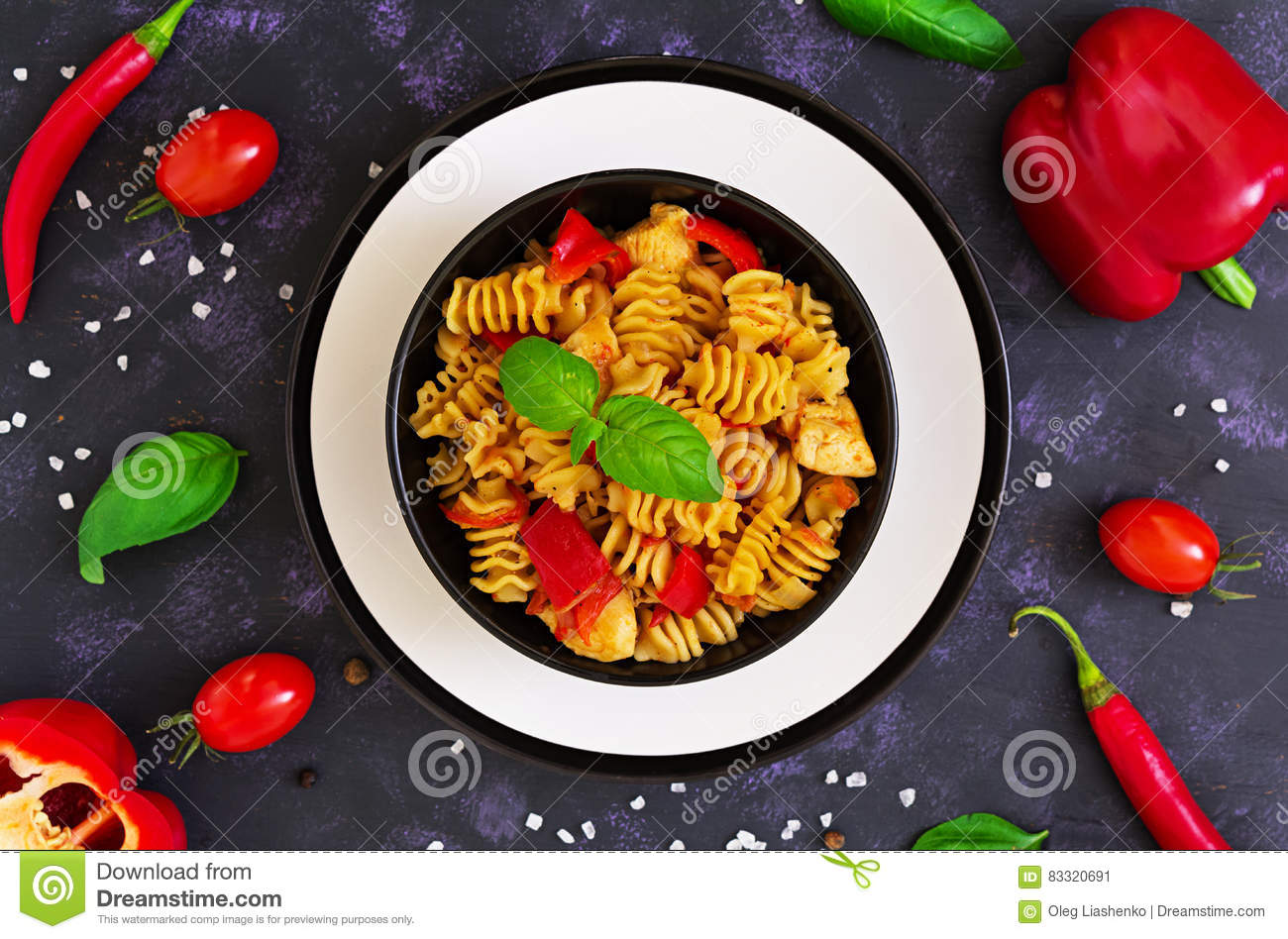 Radiatori Pasta With Chicken And Peppers On Dark Background Top View