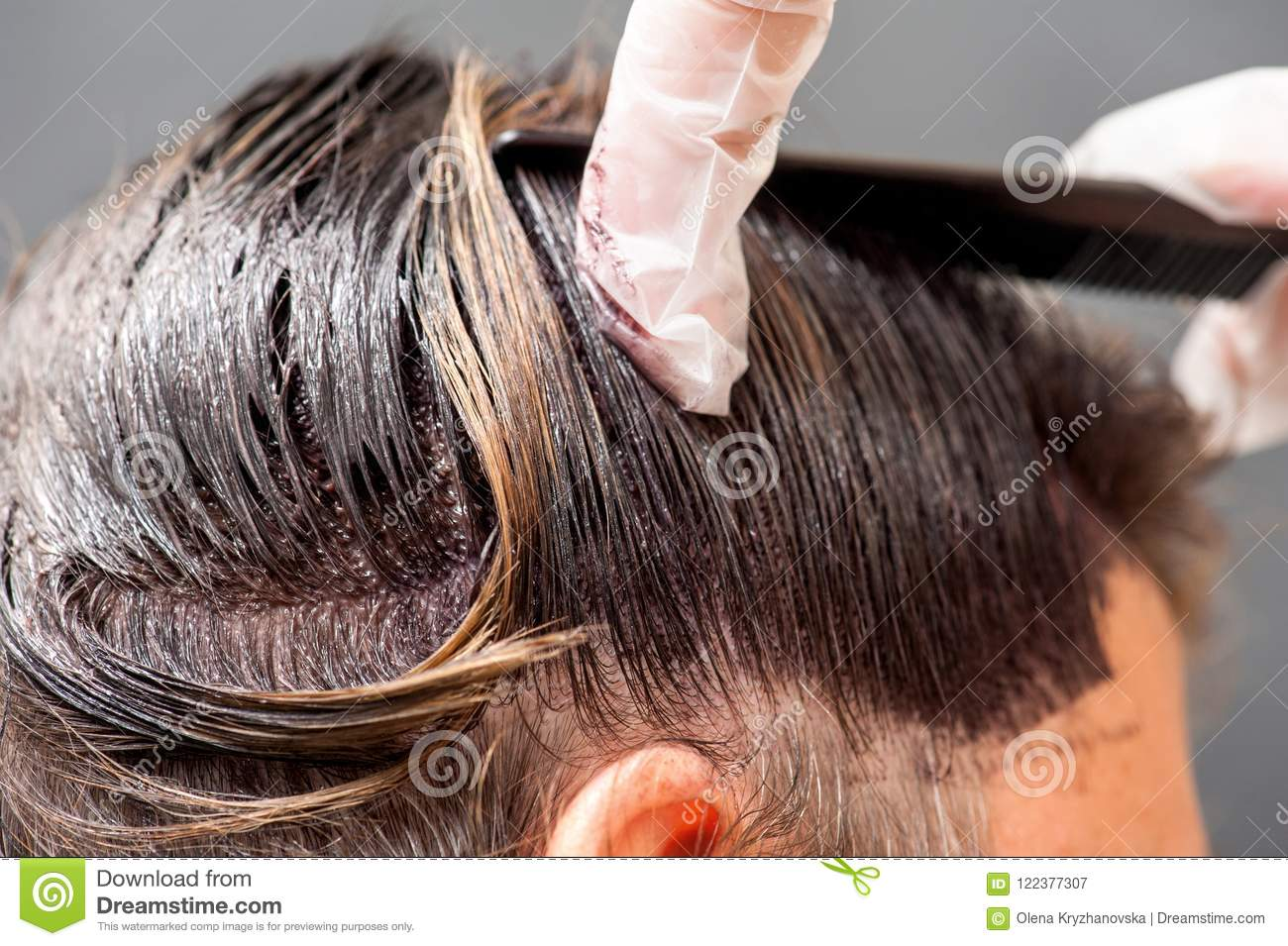 A Radical Change Of Hair Color On Gray Background Stock Image