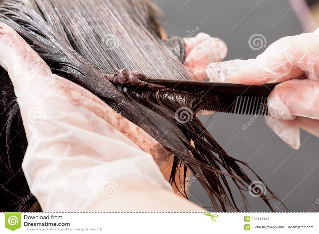 A Radical Change Of Hair Color On Gray Background Stock Photo