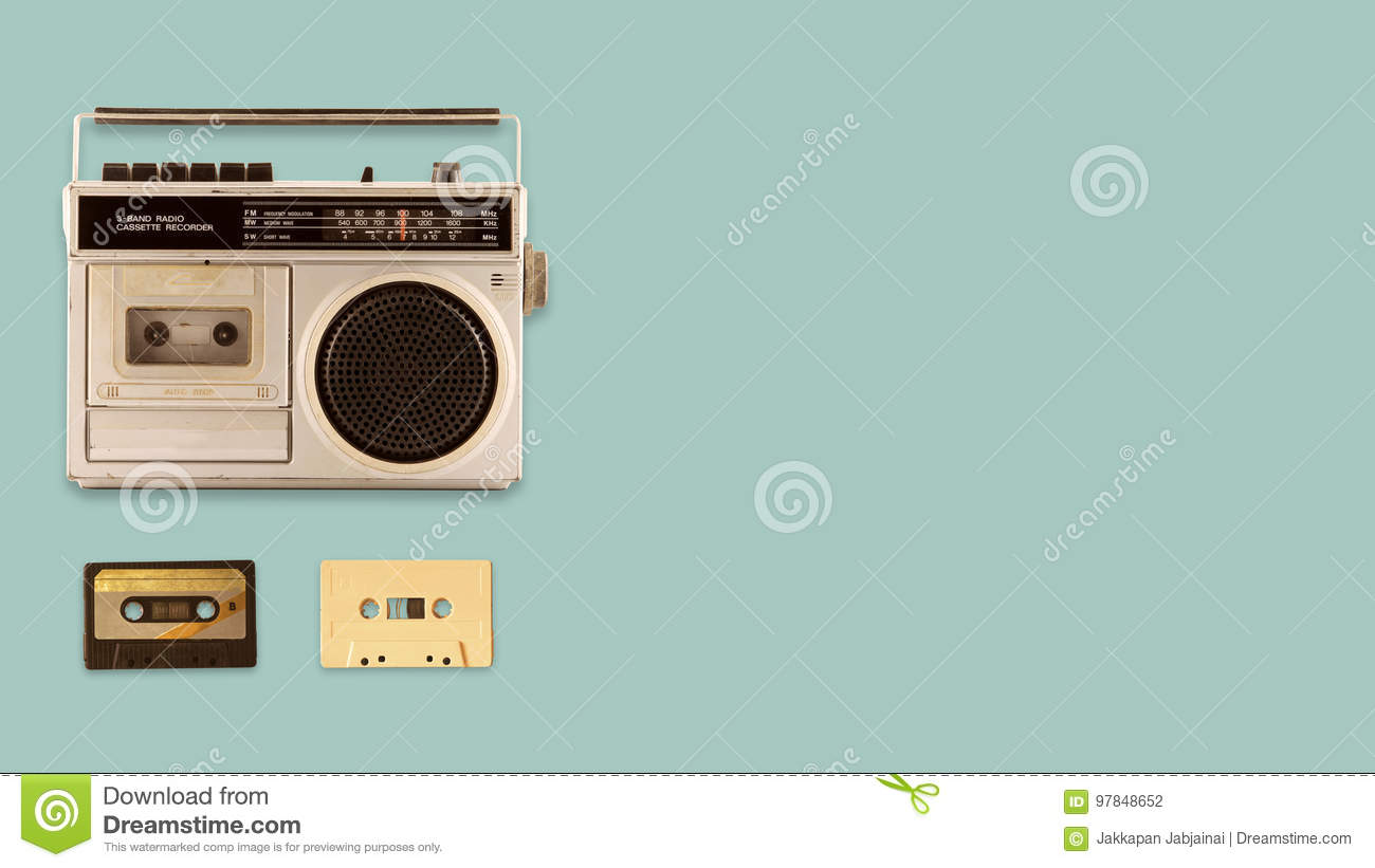 Radio cassette recorder and player with music tape cassette on color background