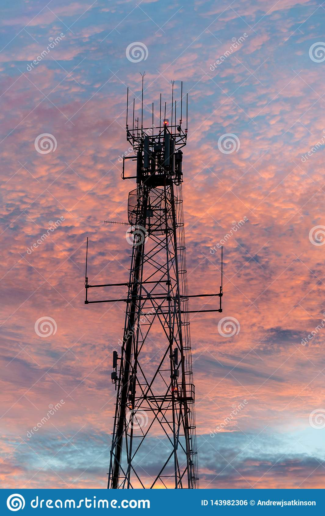 Radio and television broadcasting communications tower in Lightning Ridge back lit by a pink sunset