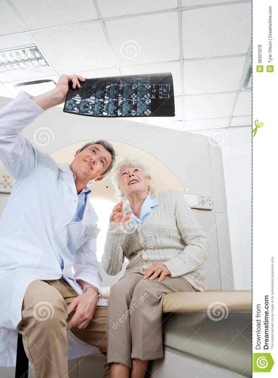 radiologist with patient looking at x-ray stock photo - image of
