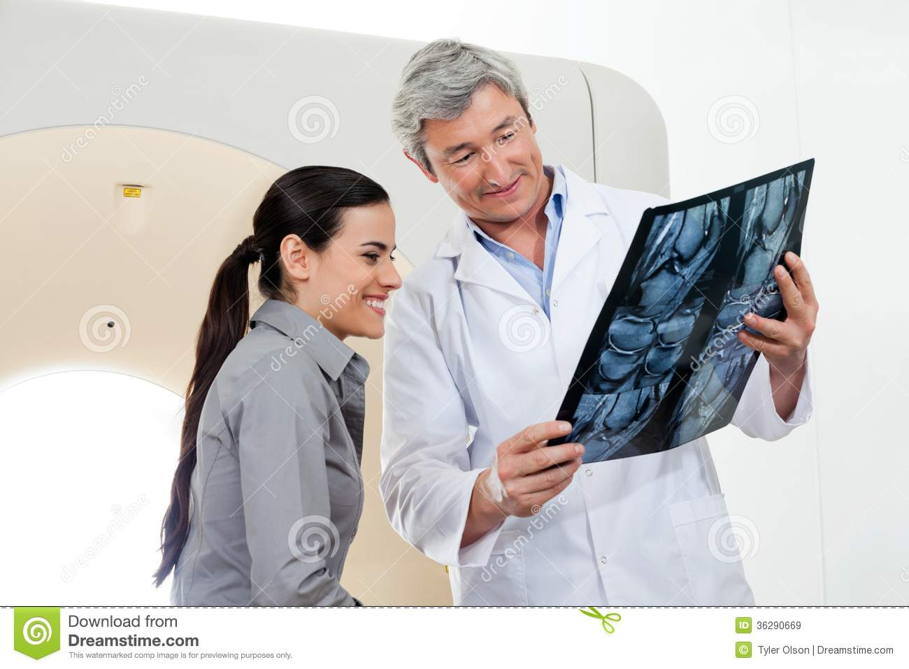 radiologist showing x-ray report to patient stock image - image of