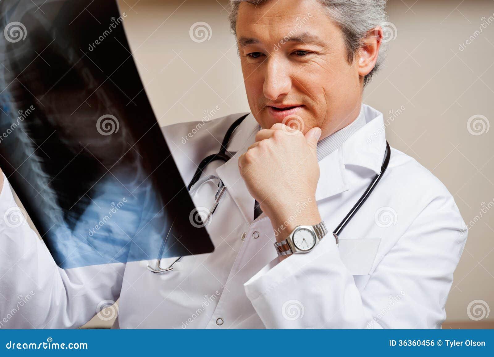 RadiologistStudyingXRayRoyaltyFreeStockImage