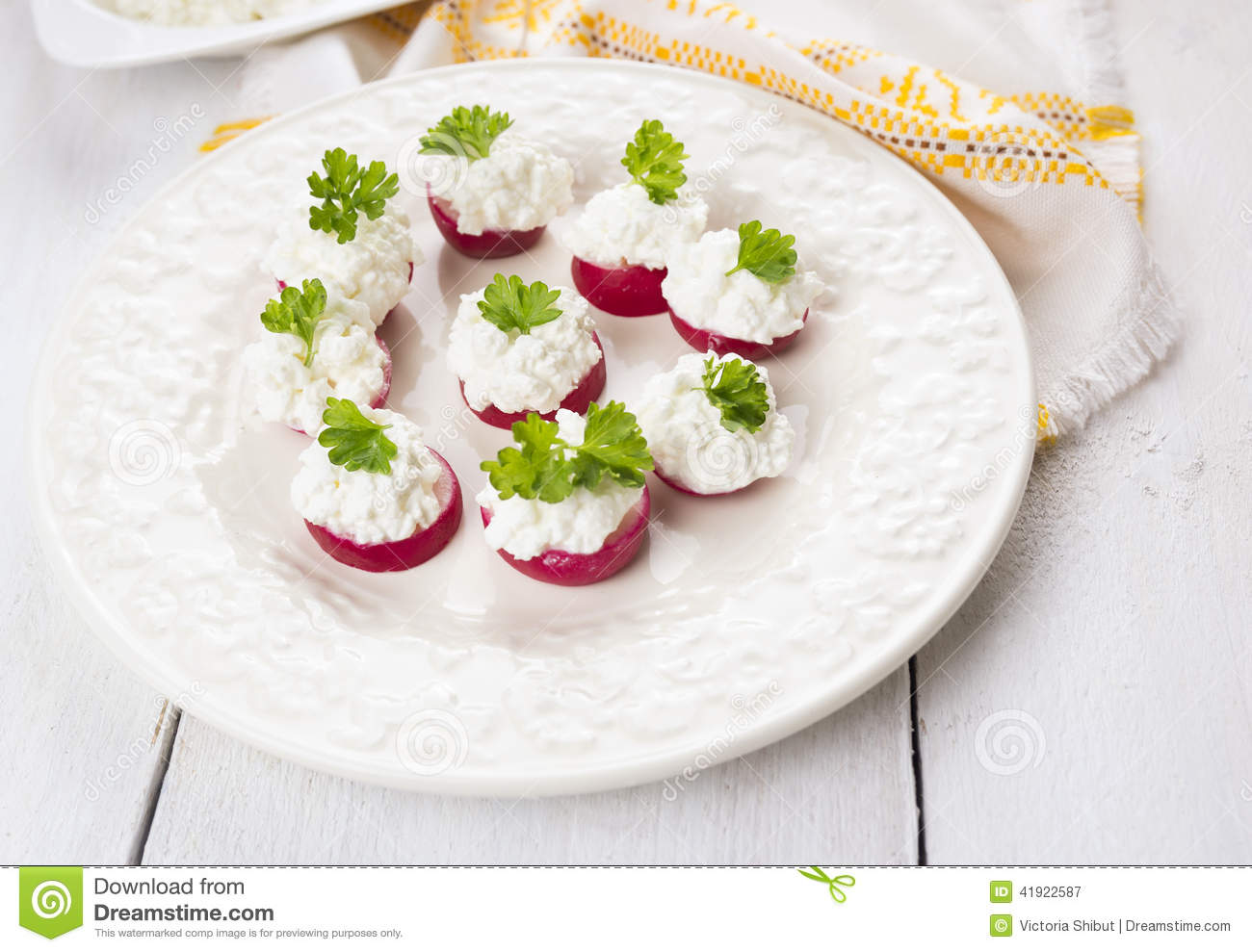 Radish cheese canape in white plate stock photo image for Canape table