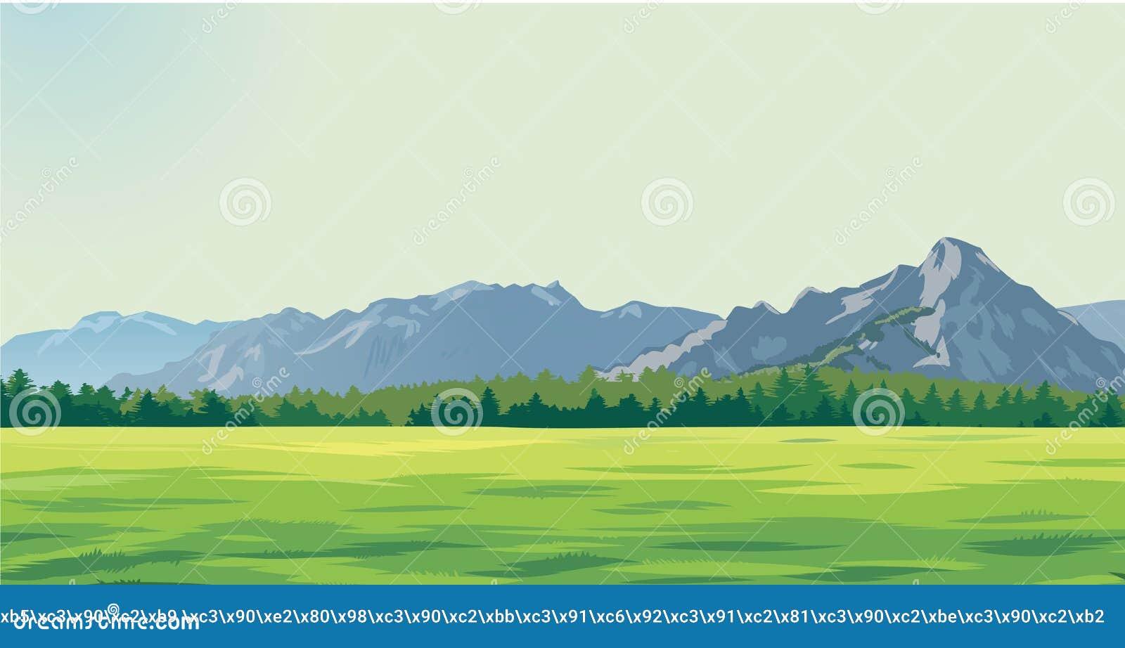 Radura verde contro lo sfondo delle montagne