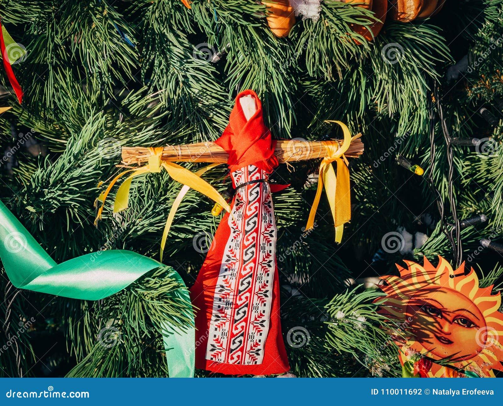 rag dolls on christmas tree on folk slavic pagan holiday maslenitsa of the end of winter