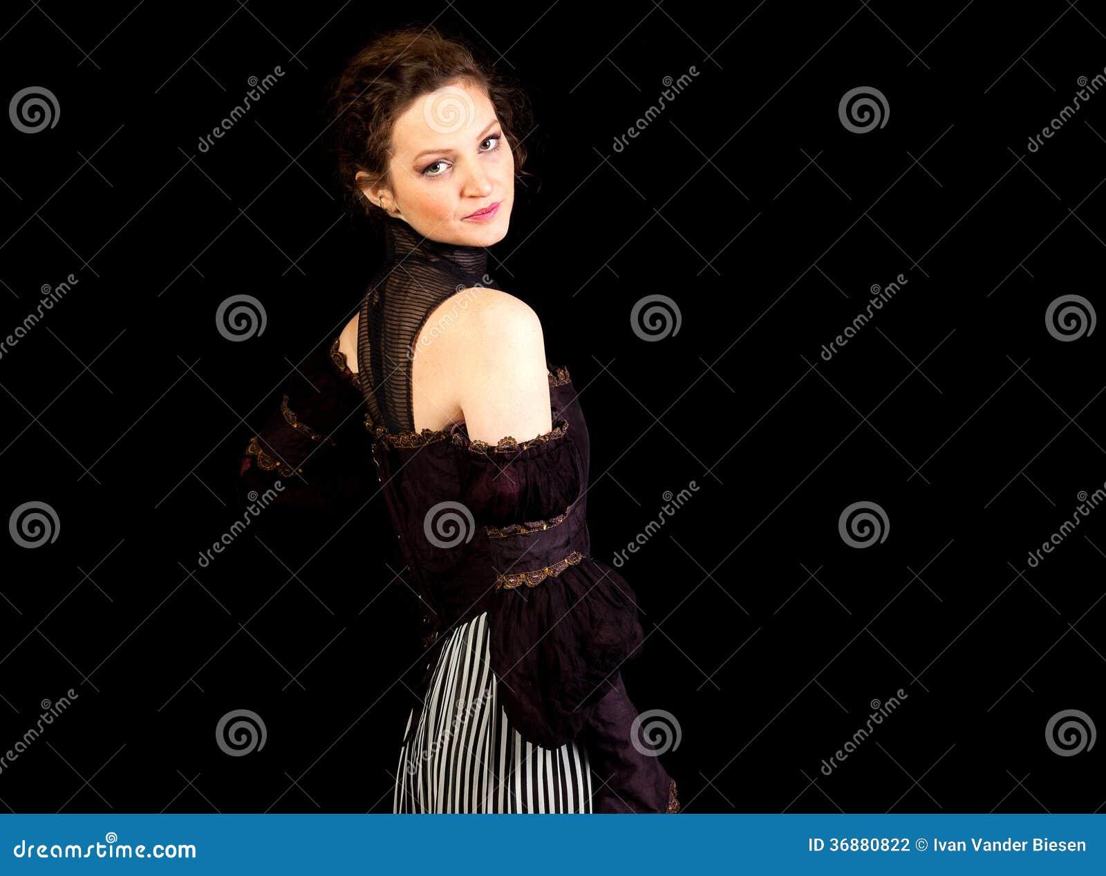 Download Ragazza In Vestito Vittoriano Scuro Che Guarda Indietro Fotografia Stock - Immagine di femmina, bello: 36880822