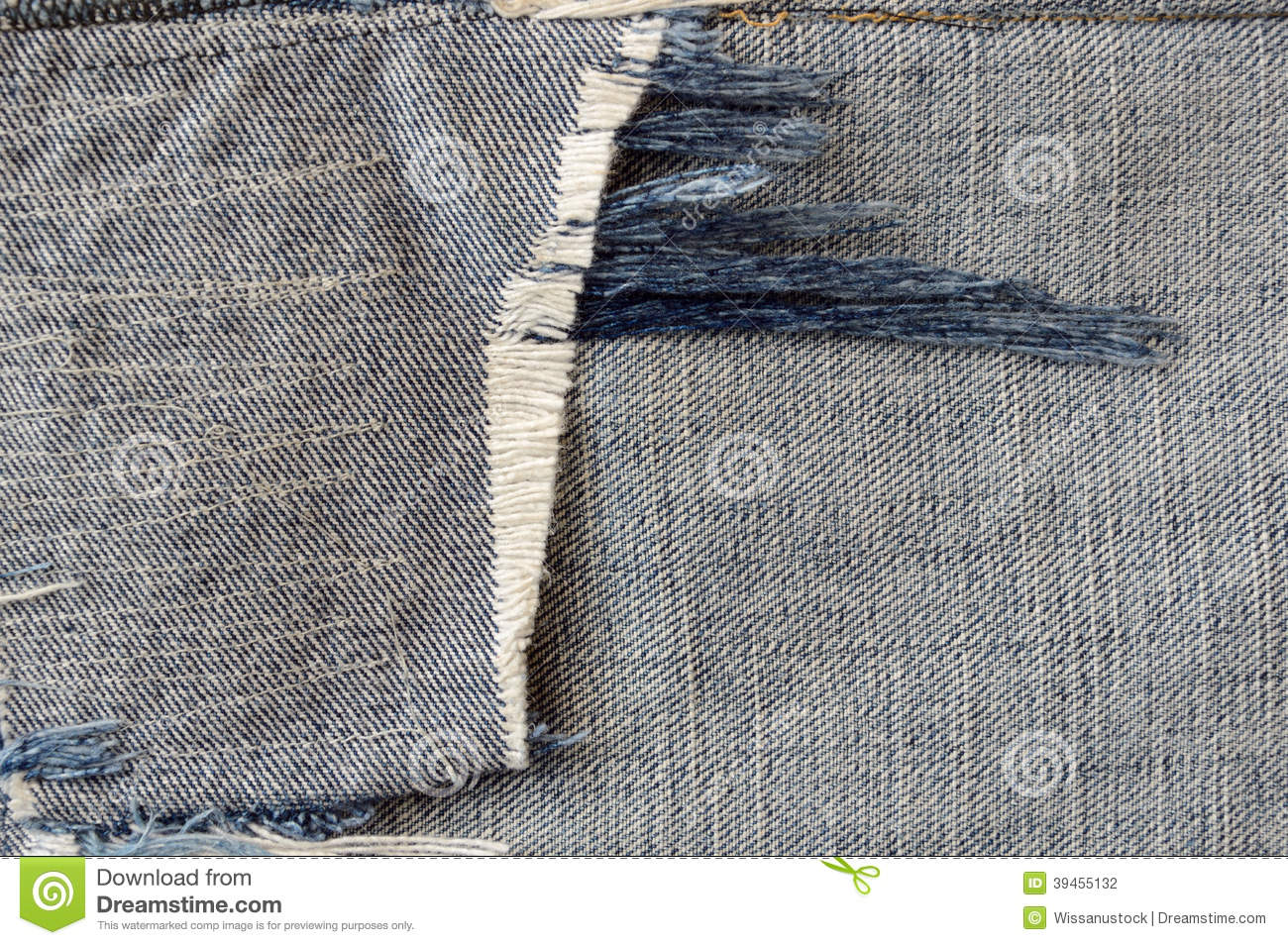 Ragged fabric of old bluejeans